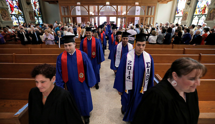Students make their way into the Saint Vincent de Paul Parish at Lincoln Park Friday, June 13, 2014, for DePaul University's Baccalaureate Mass. The event was part of the 116th commencement ceremonies for the Chicago university. (DePaul University/Jamie Moncrief)