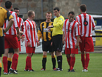 Referee Andy Milne calms down Neil Erskine and David Booth (centre) in the Huntly v Wigtown & Bladnoch William Hill Scottish Cup 1st Round match, at Christie Park, Huntly on 25.8.12.
