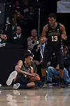 Olivier Sarr (30) of the Wake Forest Demon Deacons hits the floor to gather up a loose ball during first half action against the Syracuse Orange at the LJVM Coliseum on January 3, 2018 in Winston-Salem, North Carolina.  The Demon Deacons defeated the Orange 73-67.  (Brian Westerholt/Sports On Film)