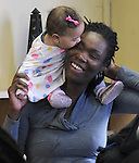 Tashena Dixon with her daughter Malia Dixon (age 5 1/2 months) seen at the Naming Ceremony Event, at the A.J. Williams-Myers African Roots Community Center, at 43 Gill Street, in Kingston, NY, on Saturday, February 18, 2017. Photo by Jim Peppler; Copyright Jim Peppler 2017