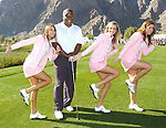 HOPE20ripE.jpg.( 01/19/11, La Quinta, Metro ) Bo Jackson smiles as the Bob Hope Girls (from left) Samantha Cortese, Ashten Goodenough, Ashton Hanson, strike a Heisman Trophy pose on the 10th tee at Silver Rock Resort in La Quinta during the 2011 Bob Hope Classic on Wednesday. (Rodrigo Pena/Special to The Press-Enterprise)