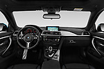 Stock photo of straight dashboard view of 2017 BMW 4 Series Gran Coupe M Sport 5 Door Hatchback