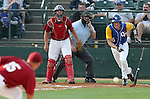SIOUX FALLS, SD - MAY 26:  Austin Ridl #6 from O'Gorman watches the ball bounce to first baseman Scott Tyler #15 from Roosevelt in the first inning during the Class A Championship Game Saturday night at the Sioux Falls Stadium. (Photo by Dave Eggen/Inertia)