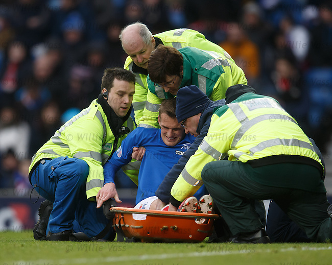 Dean Shiels carefullly lowered into a stretcher after getting injured