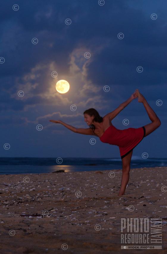 Full moon rising, the perfect time for yoga on a beach at Kauai