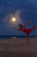 Full moon rising, the perfect time for yoga on a beach at Kauai