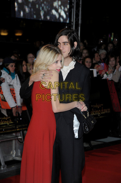 Peaches Geldof & Thomas Cohen.'The Twilight Saga: Breaking Dawn Part 2' European film premiere, Empire cinema, Leicester Square, London, England..14th November 2012.half length dress black suit side profile married husband wife red sleeveless tattoos arm around over shoulder hug embrace .CAP/PL.©Phil Loftus/Capital Pictures.