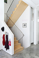 A steep flight of steps ascends from the open plan living area on the ground floor to the bedrooms on the first floor