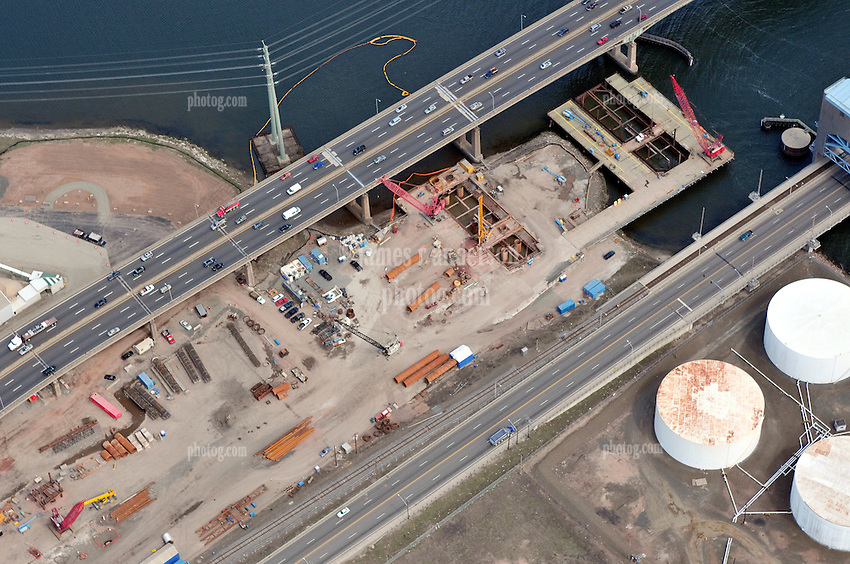 """Overview of Pearl Harbor Memorial """"Q"""" Bridge New Construction near Interstate I-95 I-91 CT Route 34 Interchanges. Part of the I-95 New Haven Harbor Crossing Corridor Construction Project. Photography captured at the beginning of Contract B1 & E1 of coffer damns and pier construction. West end of Harbor Crossing."""