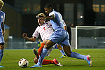 08 October 2013: Clemson's Kyle Fisher (2) and North Carolina's Omar Holness (JAM) (14). The University of North Carolina Tar Heels hosted the Clemson University Tigers at Fetzer Field in Chapel Hill, NC in a 2013 NCAA Division I Men's Soccer match. Clemson won the game 2-1 in overtime.