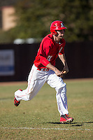 Weston Clarke (21) of the Belmont Abbey Crusaders hustles down the first base line against the Shippensburg Raiders at Abbey Yard on February 8, 2015 in Belmont, North Carolina.  The Raiders defeated the Crusaders 14-0.  (Brian Westerholt/Four Seam Images)