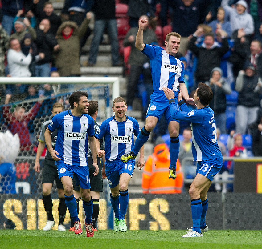 Wigan Athletic's Callum McManaman celebrates scoring his sides second goal with team-mates (LtoR) Jordi Gomez, James McArthur and Paul Scharner .. - (Photo by Stephen White/CameraSport) - ..Football - Barclays Premiership - Wigan Athletic v Tottenham Hotspur - Saturday 27th April 2013 - DW Stadium - Wigan..© CameraSport - 43 Linden Ave. Countesthorpe. Leicester. England. LE8 5PG - Tel: +44 (0) 116 277 4147 - admin@camerasport.com - www.camerasport.com