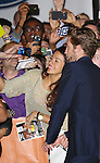 Robert Pattinson greets fans while attending the Red Carpet Arrivals for 'Maps To The Stars' at the Roy Thomson Hall during the 2014 Toronto International Film Festival on September 9, 2014 in Toronto, Canada.
