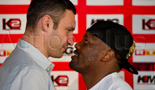 WBC Heavyweight World Champion, Vitali Klitschko (L) from the Ukraine and British boxer Dereck Chisora look at each other at a press conference held at the Olympic Hall in Munich,Germany, 15 December 2012. Klitschko intends to defend his title against Chisora on 18 February 2012 in Munich.
