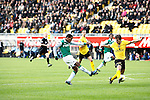 Nederland, Kerkrade, 2 november 2008 .Eredivisie .Seizoen 2008-2009 .Roda JC-Feyenoord (4-0) .Diego Biseswar (l) van Feyenoord schiet de bal door de benen van Marcel Meeuwis (r) van Roda JC en scoort, 4-0.