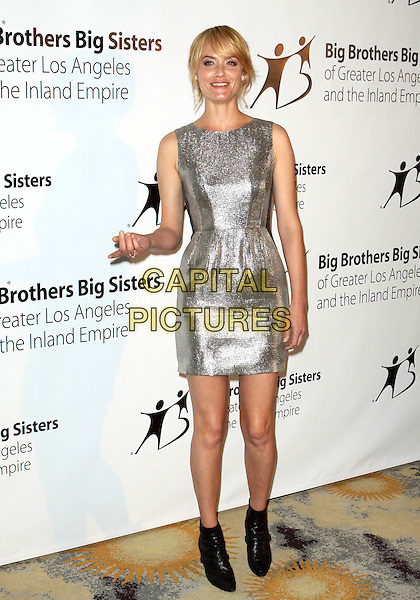 AMBER VALLETTA.Big Brothers Big Sisters Spring Luncheon 2010  held at The Beverly Hills Hotel, Beverly Hills, California, USA..April 27th, 2010.Valetta full length dress sleeveless ankle boots black silver hand.CAP/ADM/TC.©T. Conrad/AdMedia/Capital Pictures.