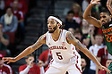 December 4, 2013: Terran Petteway (5) of the Nebraska Cornhuskers defending against the Miami (Fl) Hurricanes at the Pinnacle Bank Areana, Lincoln, NE. Nebraska defeated Miami 60 to 49.