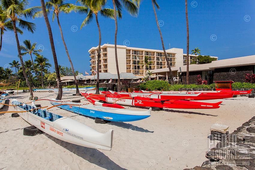 Outrigger canoes on Kamakahonu Beach in front of King Kamehameha's Kona Beach Hotel in Kailua-Kona, Big Island.