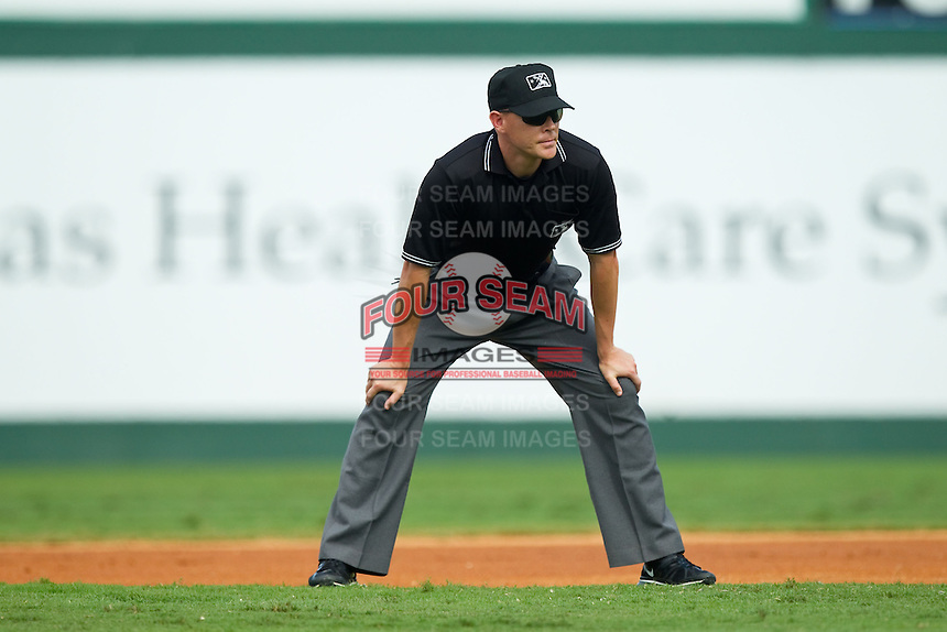 Umpire Jon Byrne handles the calls at second base during the International League game between the Durham Bulls and the Charlotte Knights at Knights Stadium on August 18, 2013 in Fort Mill, South Carolina.  The Bulls defeated the Knights 5-1 in Game Two of a double-header.  (Brian Westerholt/Four Seam Images)