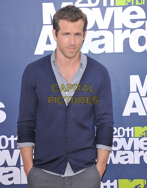 Ryan Reynolds.at 2011 MTV Movie Awards held at Gibson Ampitheatre in Universal City, California, USA, June 5th, 2011..Arrivals half length blue cardigan shirt hands in pockets               .CAP/RKE/DVS.©DVS/RockinExposures/Capital Pictures.