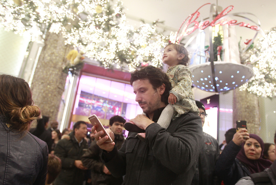 "Eager shoppers pour into the Macy's Herald Square flagship store upon store opening for ""Black Friday"" 2015 on Thursday, Nov. 26, 2015 in New York. On Thanksgiving at 6pm, most Macy's stores across the country opened its doors to thousands of early bird shoppers in search of sales, door buster deals and limited-time-offers. (Donald Traill/ AP Images for Macy's Inc)"