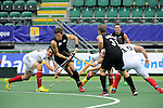 The Hague, Netherlands, June 08: Simon Child #6 of New Zealand in action against (L) Christopher Wesley #10 of Germany and (R) Martin Haener #6 of Germany during the field hockey group match (Men - Group B) between the Black Sticks of New Zealand and Germany on June 8, 2014 during the World Cup 2014 at Kyocera Stadium in The Hague, Netherlands.  Final score 3-5 (1-3) (Photo by Dirk Markgraf / www.265-images.com) *** Local caption ***