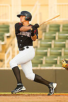Trayce Thompson #24 of the Kannapolis Intimidators follows through on his swing against the Delmarva Shorebirds at Fieldcrest Cannon Stadium on May 23, 2011 in Kannapolis, North Carolina.   Photo by Brian Westerholt / Four Seam Images
