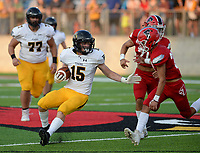 NWA Democrat-Gazette/ANDY SHUPE<br /> Prairie Grove receiver Cordelle Whetsell (15) attempts to evade Farmington safety Kyle Welkley (right) Friday, Sept. 6, 2019, during the first half of play at Cardinal Stadium in Farmington. Visit nwadg.com/photos to see more photographs from the game.
