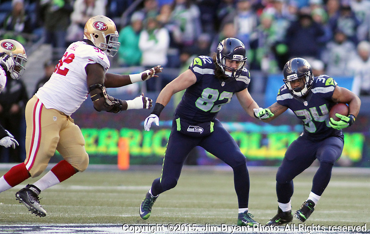 Seattle Seahawks running back Thomas Rawls (34) cuts the corner while tight end Luke Willson (82) look to block a San Francisco 49ers defender at CenturyLink Field in Seattle, Washington on November 22, 2015.  The Seahawks beat the 49ers 29-13.   ©2015. Jim Bryant Photo. All RIghts Reserved.