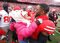 Ohio State Buckeyes player Jordan Hall gets a hug from Halle Fields, 4, the younger sister of teammate Chris Fields, as nineteen seniors were recognized before Saturday's NCAA Division I football game against Indiana at Ohio Stadium in Columbus on November 23, 2013. (Barbara J. Perenic/The Columbus Dispatch)