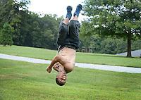 NWA Democrat-Gazette/BEN GOFF @NWABENGOFF<br /> Nathan Mithard of Bella Vista practices parkour-style flips on Sunday Sept. 6, 2015 at the Kingsdale Recreation Complex in Bella Vista.