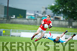 In Action E. Kerry's Niall O'Connor scores  and M'Kerry's Cormac Leane   Acorn Life Under 21 Football Championship seemi Finals East Kerry V Mid Kerry in Austin Stack Park on Thursday