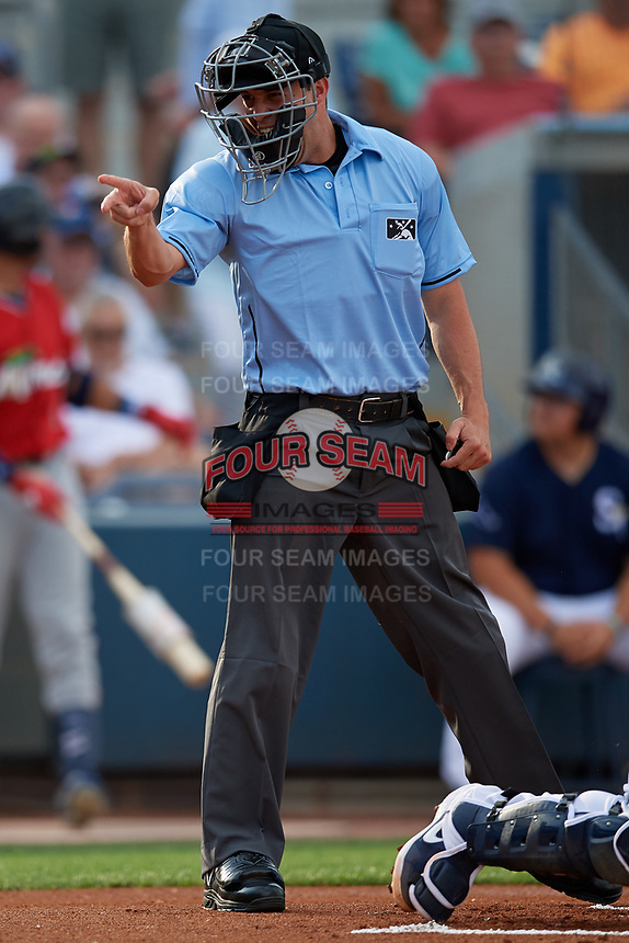 Umpire Jude Koury calls a strike during a Florida State League game between the Fort Myers Miracle and Charlotte Stone Crabs on April 6, 2019 at Charlotte Sports Park in Port Charlotte, Florida.  Fort Myers defeated Charlotte 7-4.  (Mike Janes/Four Seam Images)