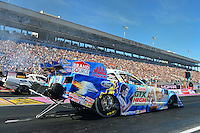 Oct. 27, 2012; Las Vegas, NV, USA: NHRA funny car driver John Force (near) races alongside teammate Mike Neff during qualifying for the Big O Tires Nationals at The Strip in Las Vegas. Mandatory Credit: Mark J. Rebilas-