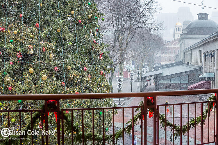 Holiday decorations and a December snowfall at Quincy Market, the Fabeuil Hall Marketplace, Boston, Massachusetts, USA