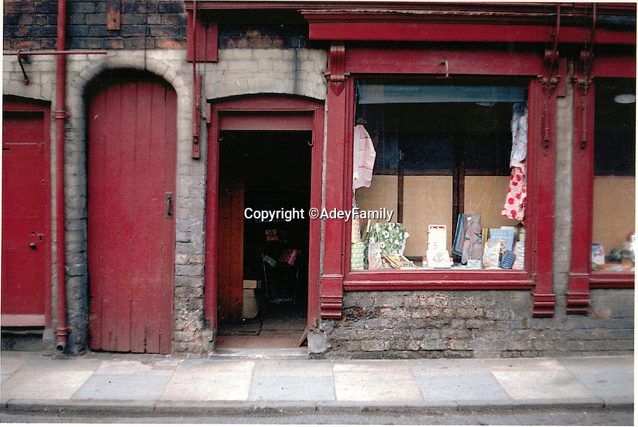 BNPS.co.uk (01202 558833)<br /> Pic: AdeyFamily/BNPS<br /> <br /> Re-Open All Hours...<br /> <br /> The shop in Lower Lichfield street in the 1950's.<br /> <br /> A greengrocers shop in a Victorian two up two down has been reunited with the family that once owned it after it was painstakingly rebuilt at the Black Country Living Museum in Dudley.<br /> <br /> The turn-of-the-century greengrocers shop has re-opened for business almost a 100 years after it served its first customers - and it is an exact replica of how it used to be.<br /> <br /> Plucky housewife Gertrude Adey transformed her modest front room into a fruit and veg shop in 1916 to earn a few shillings so she could survive while husband William was off fighting in the First World War.<br /> <br /> In 1995 the historic building was demolished to pave the way for a new development in the town centre but 98 years after it first opened the shop is back in business after it was lovingly rebuilt brick by brick.<br /> <br /> The humble shop will only sell produce that was available at the time and any left over fruit and veg will be turned into pickles, chutneys and jams, just like it would have been back in the early 20th century.<br /> <br /> And staff will even be dressed in plain period clothing just as William and Gertrude would have worn. <br /> <br /> The opening of the time-warp shop is the culmination of a project by local historians who rebuilt the shop in the grounds of the Black Country Living open air museum.<br /> <br /> Three generations of the Adey family - William's grandson Jim, 85, great grandson Andrew, 54, and great-great granddaughter Melanie, 22 - officially opened the shop on Saturday.