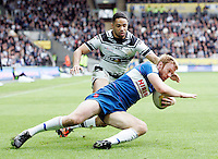 PICTURE BY VAUGHN RIDLEY/SWPIX.COM - Rugby League - Super League - Hull FC v Hull KR - KC Stadium, Hull, England - 06/04/12 - Hull FC's Will Sharp tackles Hull KR's David Hodgson.