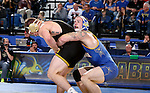 BROOKINGS, SD - DECEMBER 2:   Nate Rotert from SDSU controls Cash Wilcke from Iowa in their 197 pound match Friday night at Frost Arena in Brookings, SD.(Photo by Dave Eggen/Inertia)
