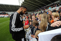 Wednesday, 23 April 2014<br /> Pictured: Kyle Bartley signing autographs for supporters.<br /> Re: Swansea City FC are holding an open training session for their supporters at the Liberty Stadium, south Wales,