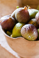 An earthenware bowl of freshly picked figs