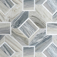 Almeria, a hand-cut stone mosaic, shown in Venetian honed Horizon Dark and polished Afyon White. Designed by Paul Schatz for New Ravenna.