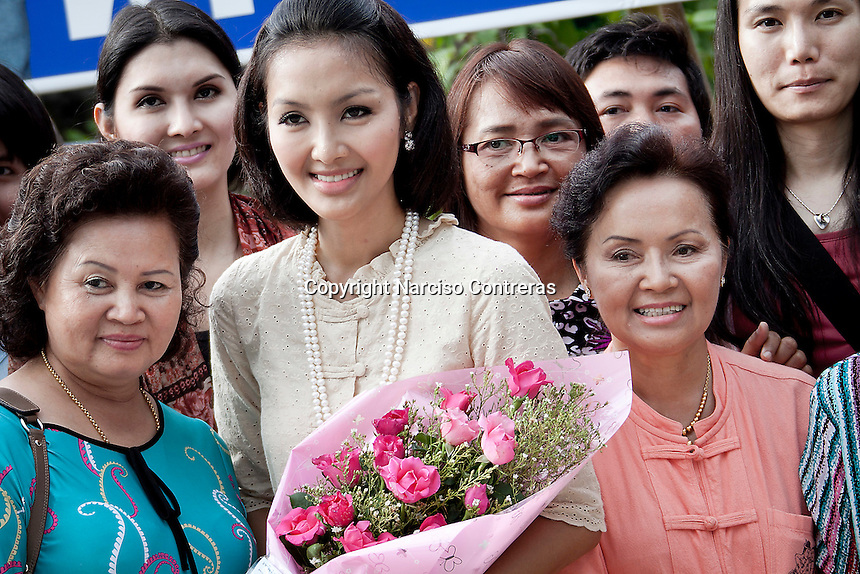 """YOLLANDA """"NOK"""" SUANYOT poses with her family and supporters to the Thai media after she was declared winner of the provincial elections for government in Nan, Thailand. Known formerly as a beauty queen, is running today a political campaign for the local rule of Nan city. 30-year-old Yollada Suanyot, who was born a male, has become the first transgender to register as an election candidate. The elections were hold on last May 27th in 24 constituencies in 15 districts, where she was declared winner with 3,812 point for the first ranking. In accord with the Thai media this is the first time in Thailand that a transgender is taking part in a provincial election."""