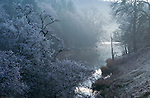 A cold, frosty winter morning, looking along the River Lowther. Lake District, Cumbria, UK
