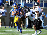 BROOKINGS, SD - NOVEMBER 5:  Brady Mengarelli #44 from South Dakota State is brought down from behind by Colby Isbell #90 form Missouri State in the first half Saturday afternoon at Dana J. Dykhouse Stadium in Brookings. (Photo by Dave Eggen/Inertia)