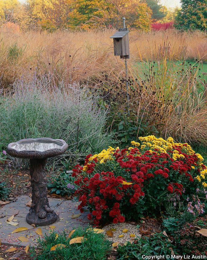 Bureau County, IL:  Birdbath and garden of fall flowers at the edge of a tall grass prairie