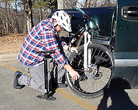 NWA Democrat-Gazette/FLIP PUTTHOFF <br /> Brannon Pack, executive director of the Ozark Off Road Cyclists, airs up his tires Feb. 3 2017 before a mountain bike ride around Lake Fayetteville.
