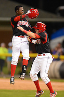 Batavia Muckdogs shortstop Javier Lopez (35) jumps into the arms of Austin Dean (3) after a walk off win during a game against the State College Spikes on June 29, 2013 at Dwyer Stadium in Batavia, New York.  Batavia defeated State College 5-4.  (Mike Janes/Four Seam Images)