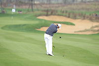 Marc Warren (SCO) plays his 2nd shot on the 14th hole during Sunday's Final Round of the 2014 BMW Masters held at Lake Malaren, Shanghai, China. 2nd November 2014.<br /> Picture: Eoin Clarke www.golffile.ie