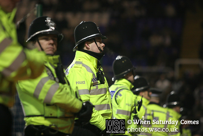 Birmingham City 0 Liverpool 7, 21/03/2006. St Andrews, FA Cup 6th Round. Birmingham City (blue) versus Liverpool,  The home side lost 0-7. Picture shows police stand on duty at the pitch side at the end of the match. Photo by Colin McPherson.