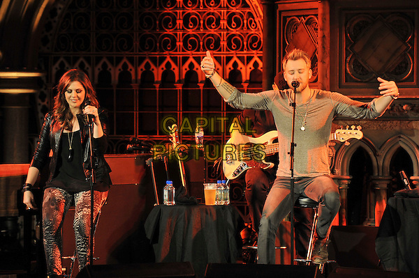 Hillary Scott, Charles Kelley  of Lady Antebellum.Perform Live in concert at the Union Chapel, London, England, UK, 7th October 2011..half  length music concert gig on stage country group band black sitting leather jacket grey gray top stools singing arms .CAP/MAR.© Martin Harris/Capital Pictures.